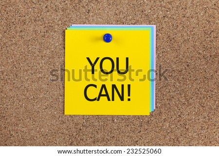 "Post-it notes with word ""You can!"" on corkboard (bulletin board). - stock photo"