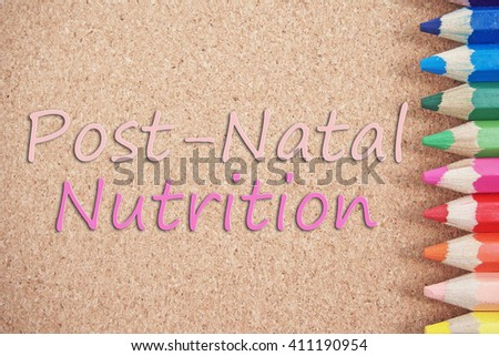 post natal nutrition text on brown board - stock photo