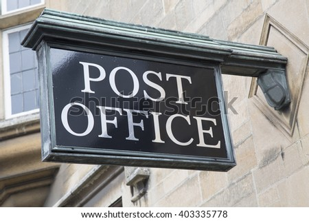 Post Office Sign on Stone Facade