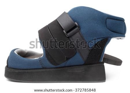 Post operative heel off-loading shoe on white background - stock photo