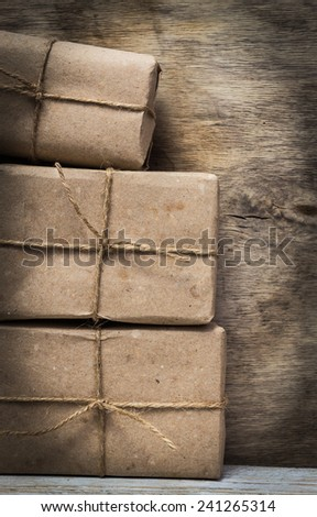 Postage on the background of an old wooden board - stock photo