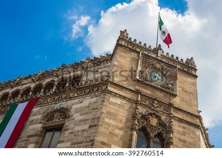 Postal palace building with mexican flag in mexico city downtown. - stock photo