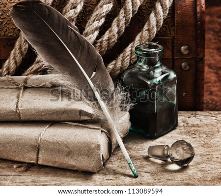 postal parcel, tobacco pipe and inkwell,  still life - stock photo