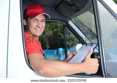 Postal service. Delivery of a package through a delivery service - stock photo