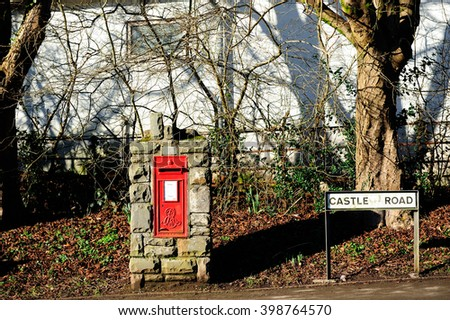 Postbox and street sign in England, UK - stock photo