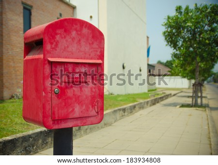 Postbox beside the road in countryside - stock photo
