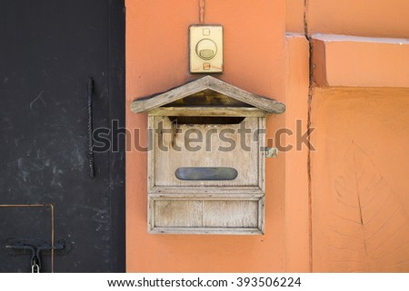 postbox mounted in a cotswold stone wall - stock photo