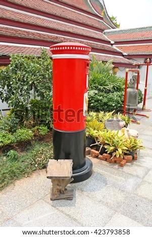 Postbox Thailand on bench - stock photo