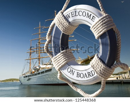 postcard of view on the sailing ship thrue blue safe belt with welcome on board sign - stock photo