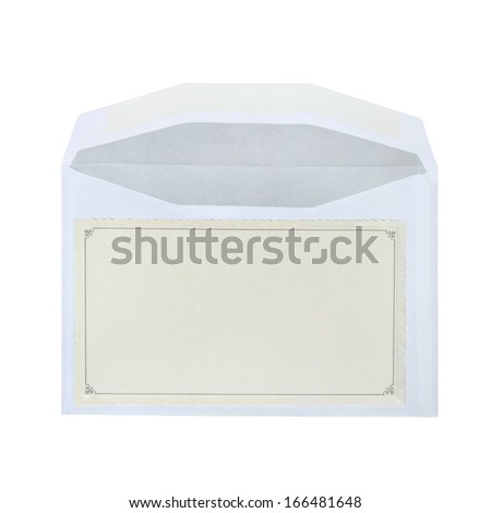 Postcard with blank space for text message lies on open envelope isolated on white background