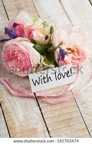 Postcard with fresh flowers and tag  - stock photo