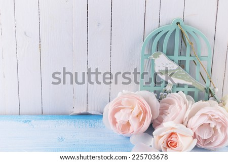 Postcard with fresh flowers on wooden background. Selective focus. - stock photo