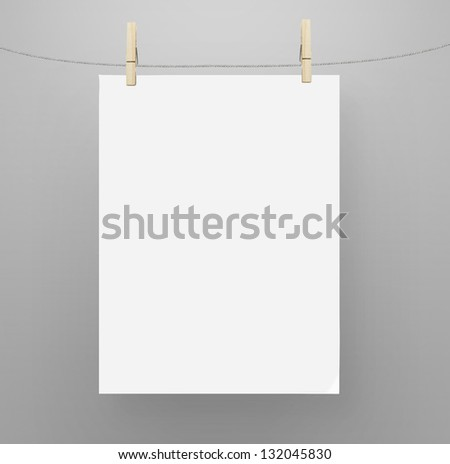 poster hanging on a rope - stock photo