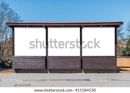 Poster mock up of street market empty wooden stall on sidewalk - stock photo