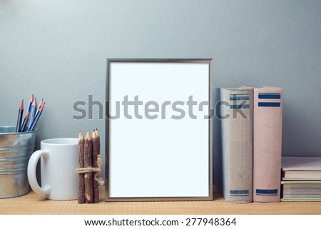 Poster mock up template with books and desk objects - stock photo