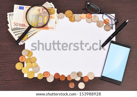 poster, phone and money in the office - stock photo