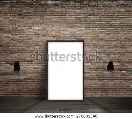 poster standing next to a brick wall - stock photo