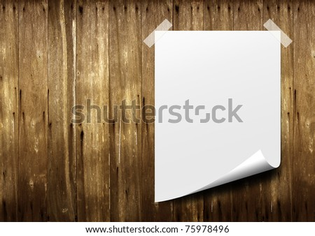 Poster white paper. Stick tape on old wood background. - stock photo