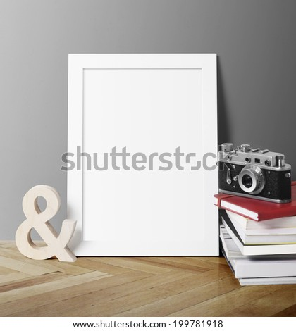 Poster with books and camera - stock photo