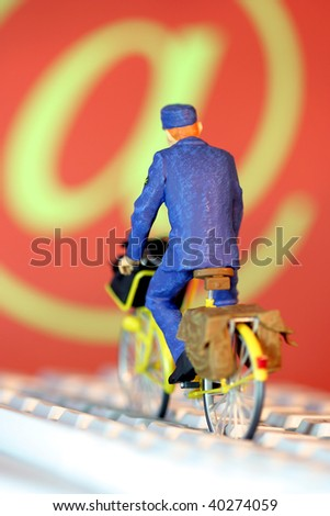 Postman on a bicycle delivering mails - stock photo