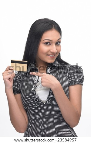 Posture of Asian girl showing the  credit-card - stock photo