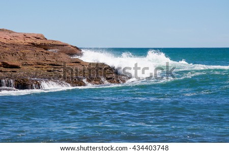 Pot Alley coast line with red sandstone formations and Indian Ocean waters in Kalbarri, Western Australia/Red Sandstone and Rushing Waters/Pot Alley, Kalbarri, Western Australia - stock photo