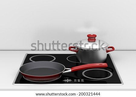 Pot and frying pan at the induction stove - stock photo