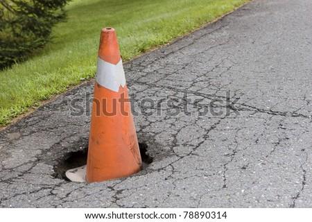 Pot hole - stock photo