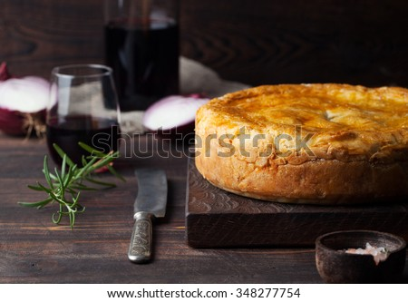 Pot Meat Pie with wine Wooden background Copy space - stock photo