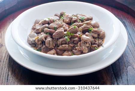 Pot of beans cooked with tomatoes and oil - stock photo