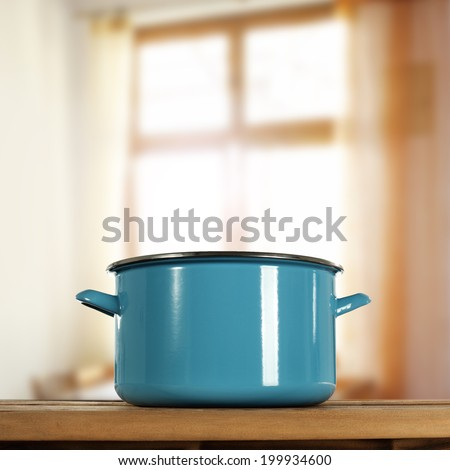 pot of blue and window in room  - stock photo
