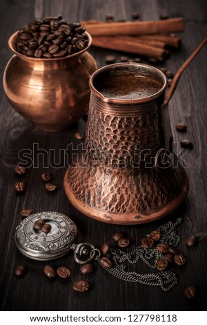 Pot of coffee, coffee beans and vintage watches. Still life. - stock photo