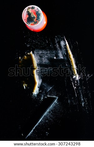 Pot of drugs and a line of cocaine cut with razor blade on mirror  - stock photo