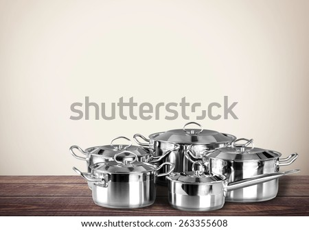 Pot. Stainless steel pots and pans isolated on white background - stock photo