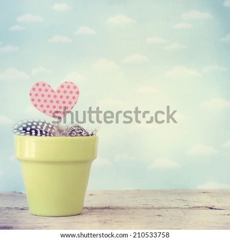 Pot with heart - stock photo