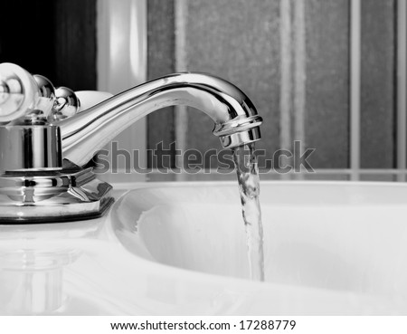 potable sink running water, black and white