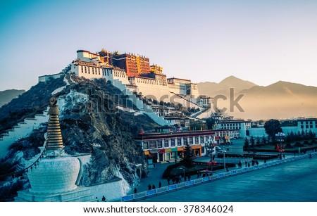 Potala Palace and stupa at dusk in Lhasa, Tibet - stock photo