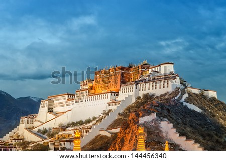Potala Palace in Lhasa ( Tibet ) on cloudy day ( photo taken in the evening ) - stock photo