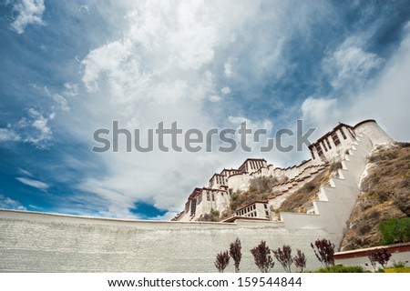 Potala palace in Tibet with beautiful sky (side view) - stock photo