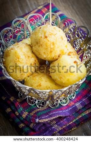 Potato balls stuffed with mushrooms, crispy-fried tasty dish - stock photo