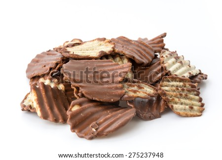 potato chip with chocolate on white - stock photo