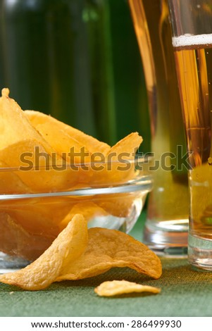 potato chips and beer - stock photo