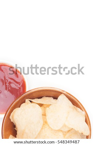 potato chips and catchup on white background