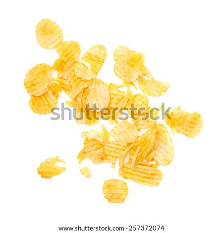 Potato chips crumbs and leftovers isolated over the white background - stock photo