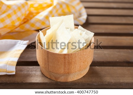 potato chips in a bowl on a table, selective focus