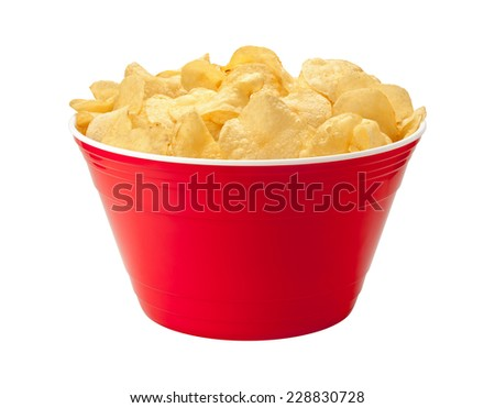 Potato chips in a red plastic party bowl. A salty snack associated with parties, and watching sporting events, often served with salsa dip.