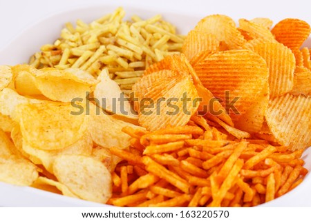 Potato chips in bowl, closeup image. - stock photo