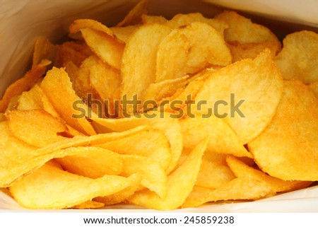 Potato chips in packing close-up  - stock photo