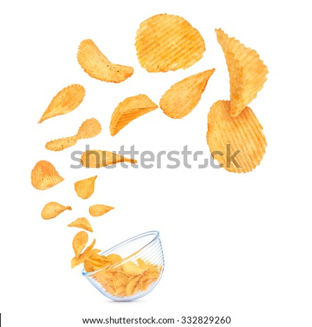 potato chips in the air fall in a bowl isolated on white background - stock photo