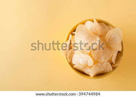 potato chips in the bowl, the top view - stock photo